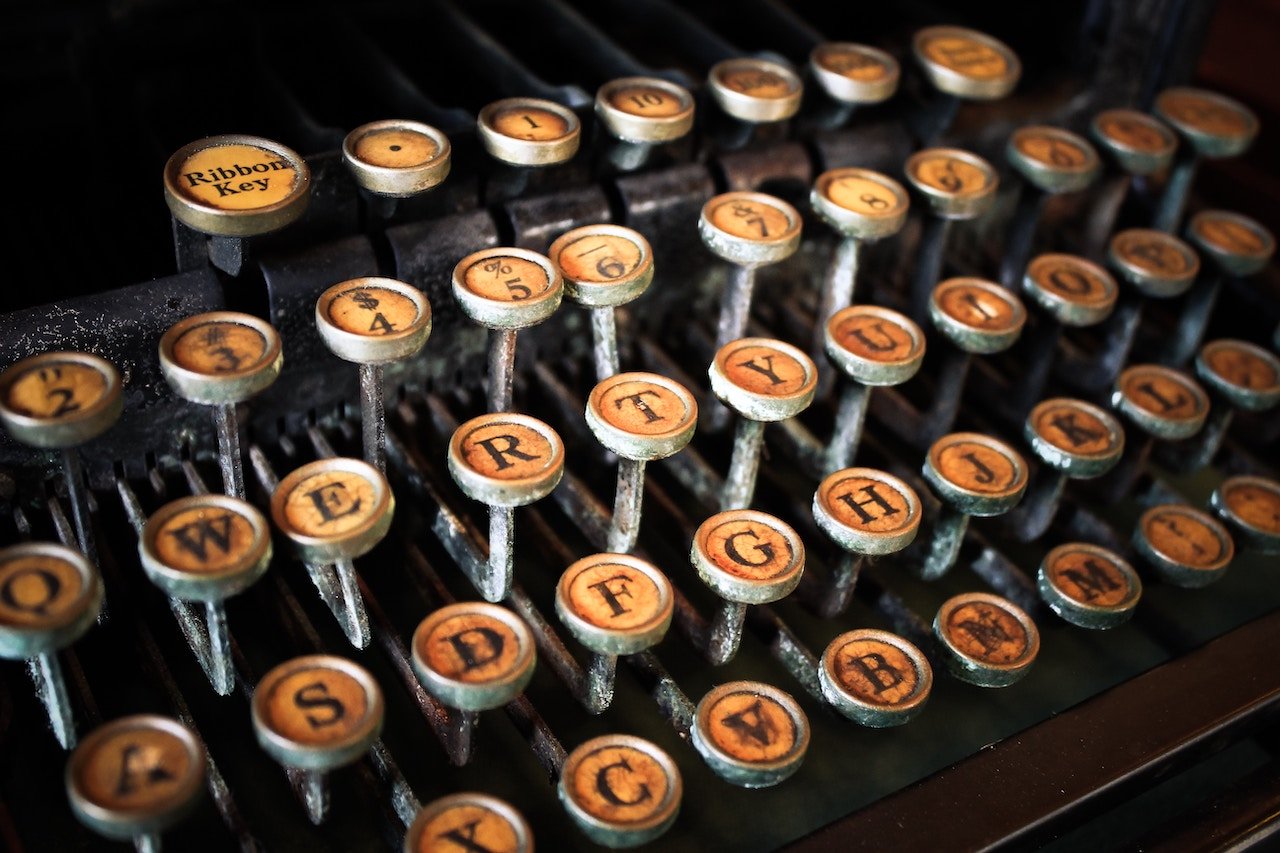 close-up photography of yellow typewriter